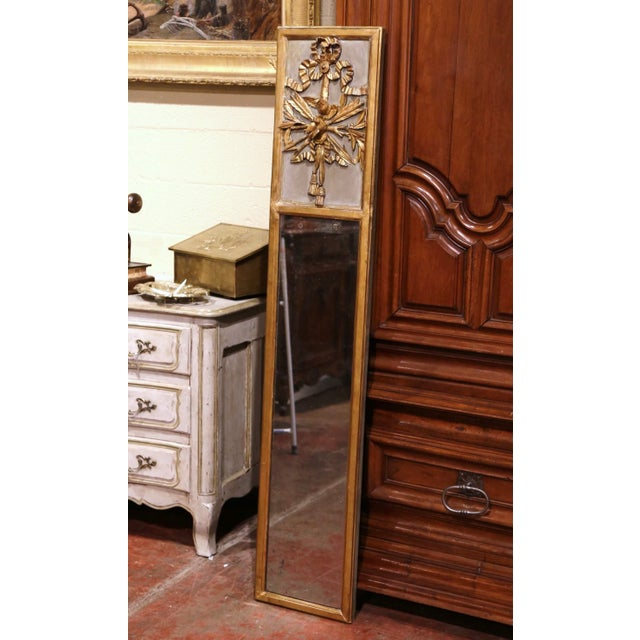 Decorate a dressing room or hallway with this 6 foot tall and narrow antique gold leaf trumeau! Crafted in the Burgundy...