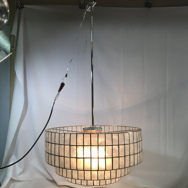 This unique West Elm chandelier would look great in a living room, bedroom, or library! The design is simultaneously...