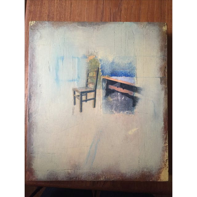 Mixed media collage composed of oil on wood. This stark, moody image features a kitchen chair and table vignette.