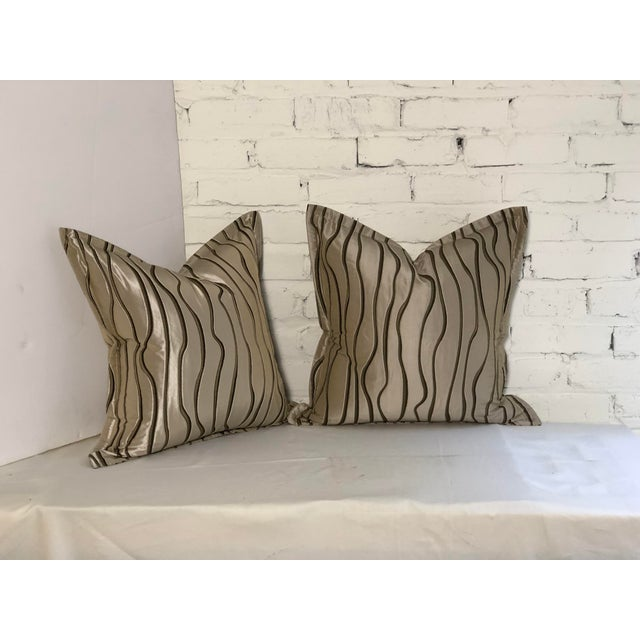 Fabulous pair of flange edge Jim Thompson pillows in a shimmery champagne fabric with abstract chocolate vertical lines....