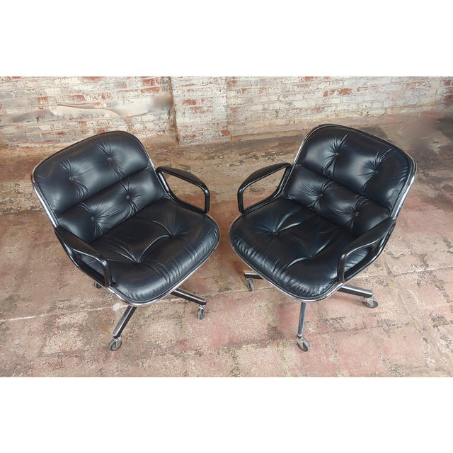 A pair of Charles Pollock 1960s Executive Chairs in Black Leather for Knoll. Black leather and chrome frame, original...
