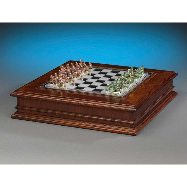 Magnificent emeralds and rubies comprise this stunning Indian chess set. Carved with the utmost skill by artists in...