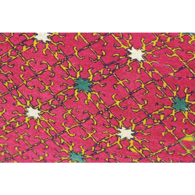 With bold hues and elaborately scrolled motifs, this beautiful antique Swati pillow features silk floss embroidery on...