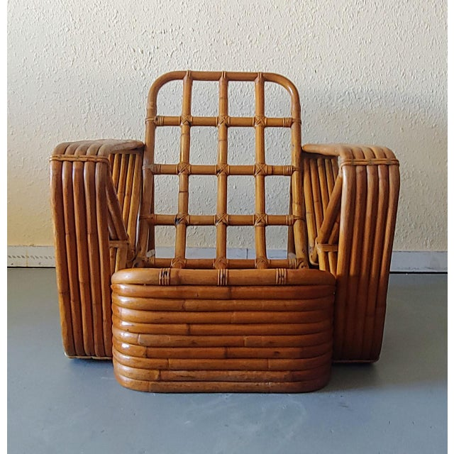 Vintage mid century modern Paul Frankl style pretzel lounge chair. Unique and rare rattan swoop seat with 5 strand arm and...