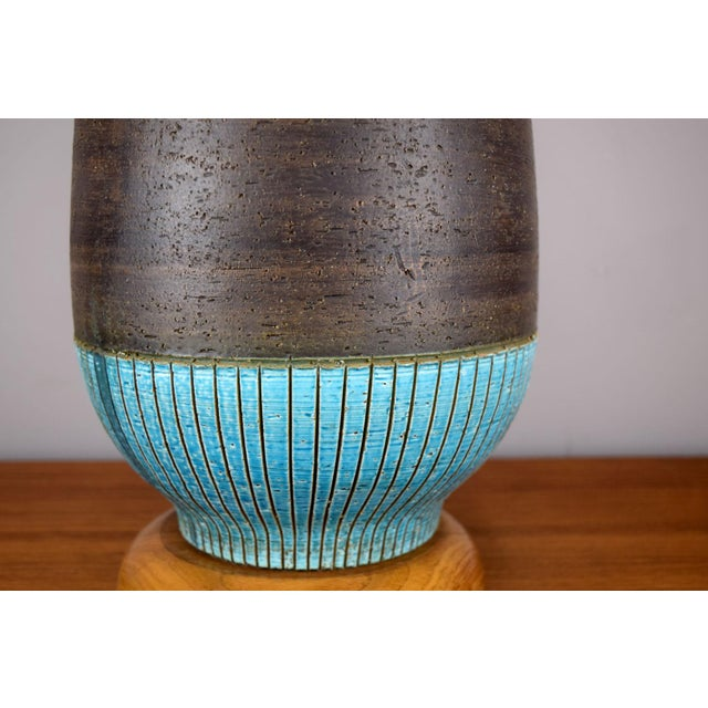 "A very large vase-form lamp with ""Rimini Blue"" glaze and incised stripe motif by Aldo Londi for Bitossi. Wilmar Lamp..."