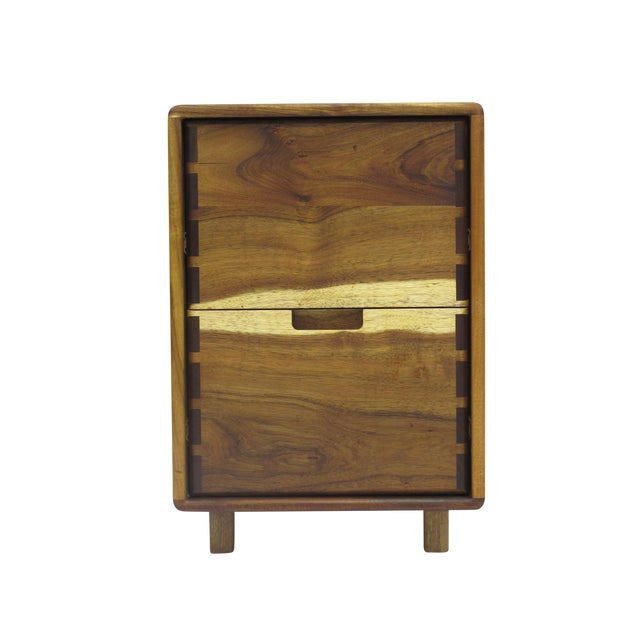 A pair of filing cabinet handcrafted of solid Koa with exposed joinery by Berkeley craftsman, Jim Sweeney.