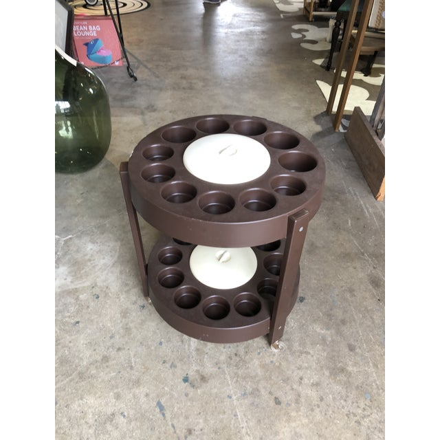 Perfect for either outdoors and indoors, this 2 tier round cart has two covered ice buckets, drink holders and bottle...