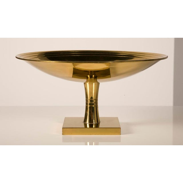 A fine polished brass footed compote consisting of a shallow circular bowl with three incised concentric rings and a...