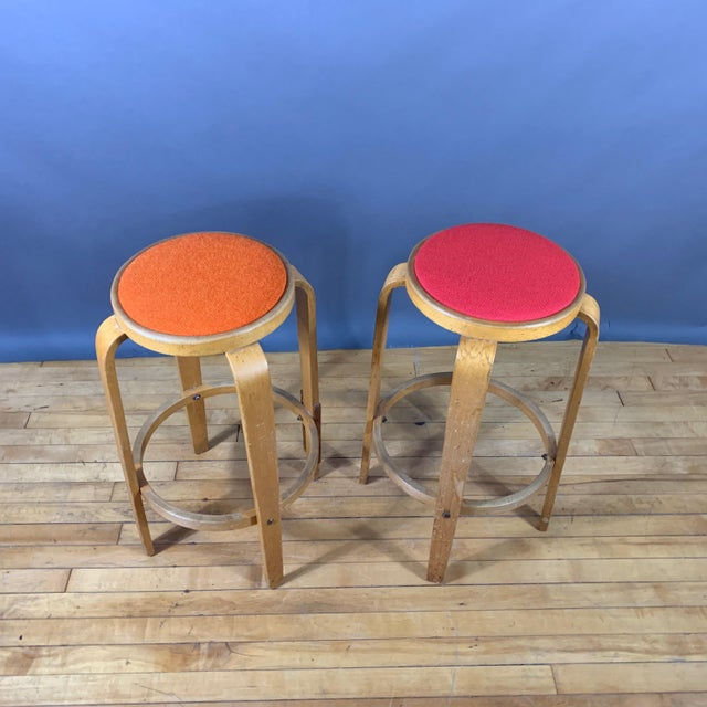 """Pair of lightly stained and lacquered bent birchwood 26.5"""" high stools in the perfect Alvar Aalto style. This pair is a..."""