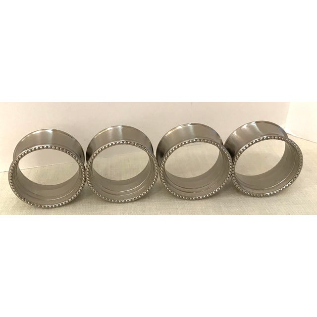 This is a nice vintage set of stainless napkin rings. The pieces feature beaded edge details.