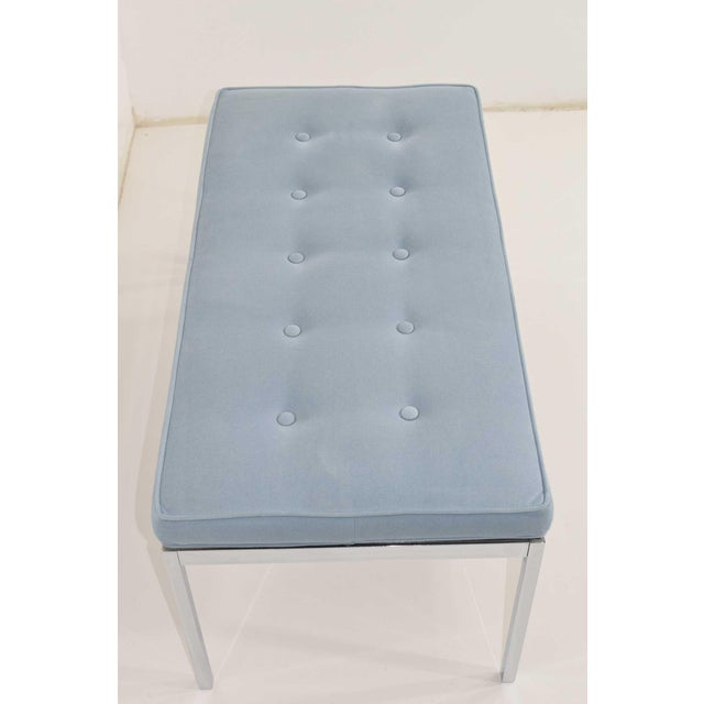 Bench is chrome with button tufted light blue microsuede cushion. We can reupholster if desired.
