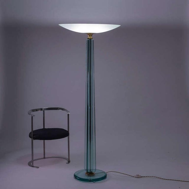 Amazing crystal and brass floor lamp. Thick glass and beautifully detailed piece. Fully restored on brass and electric...