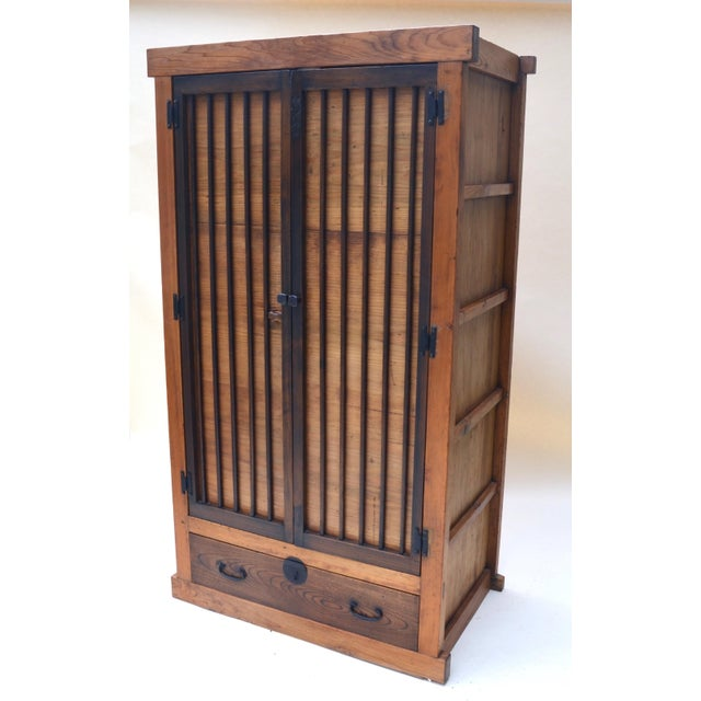 A rare attractive Japanese kimono tansu, Meiji Period (1868-1912), with hinged door and single bottom drawer. Interior is...