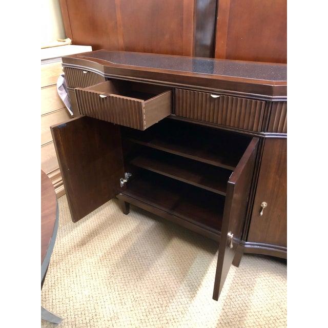 Crafted with figure flat cut walnut veneers. Terrazzano finish. Features 4 doors with adjustable shelving.