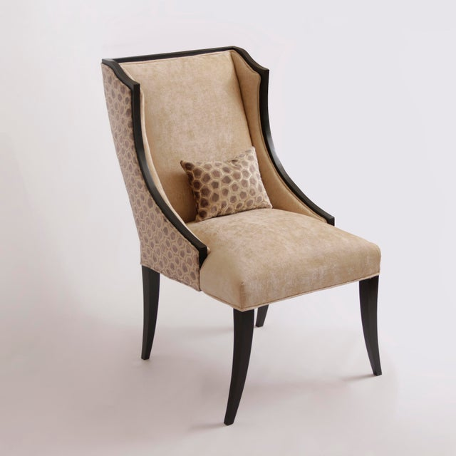 Wildly unique pair of French Art-Deco host wingback dining chairs with lap pillows. This pair has a hardy chinelle velvet...