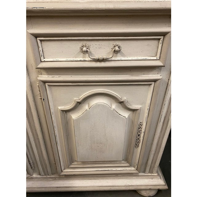 Painted French provincial Louis XV buffet consisting of four drawers, over four locking doors, resting on a plinth base...