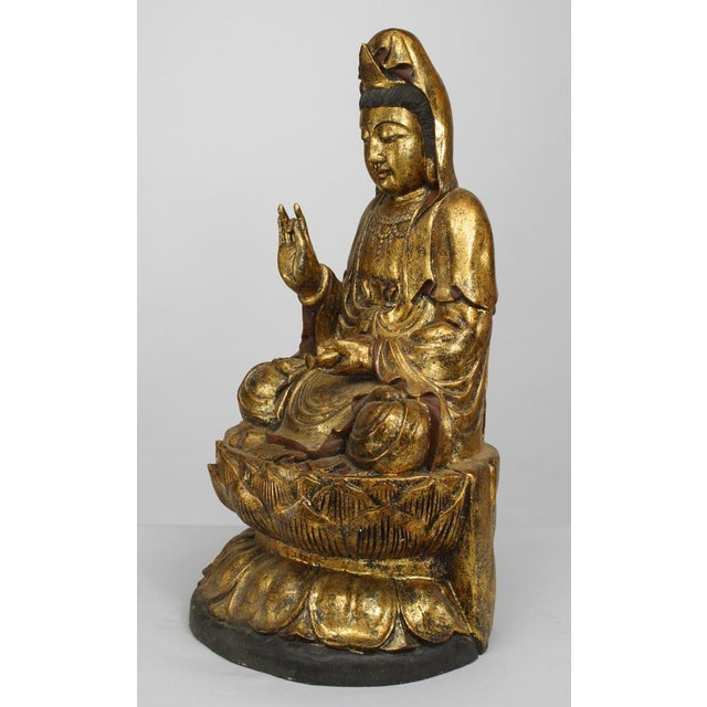 Asian Chinese Asian style gilt carved figure of seated Guan Yin Buddha on a lotus base (20th Cent)