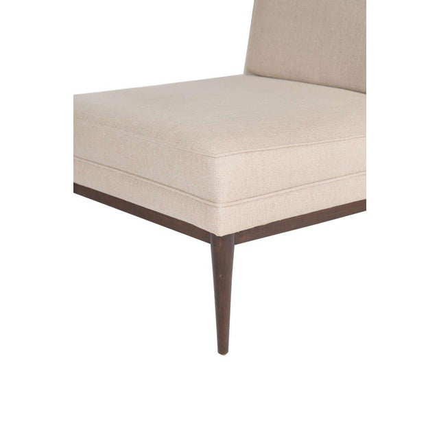 Mn Originals Colin slipper chair in a natural linen blend upholstery with solid maple turned legs and stretcher base....