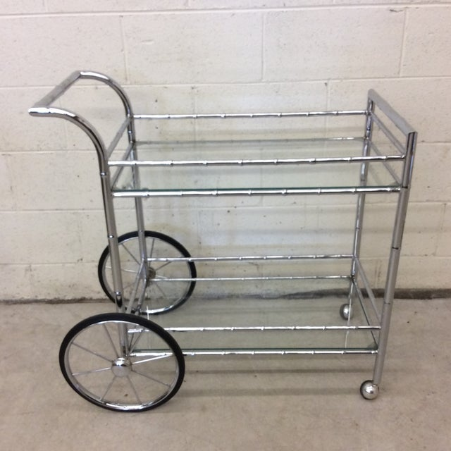Beautiful chrome Chinoiserie faux bamboo bar cart with large front spoke wheels and casters. I have seen these labeled...