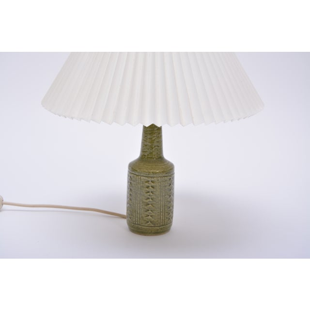 Stylish lamp from Danish Palshus with lovely grass green glaze and a Le Klint shade. The lamp is made with chamotte clay...