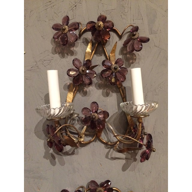 This fabulous pair of gilt wall sconces have amethyst crystals attached. In good condition overall. Should be rewired or...