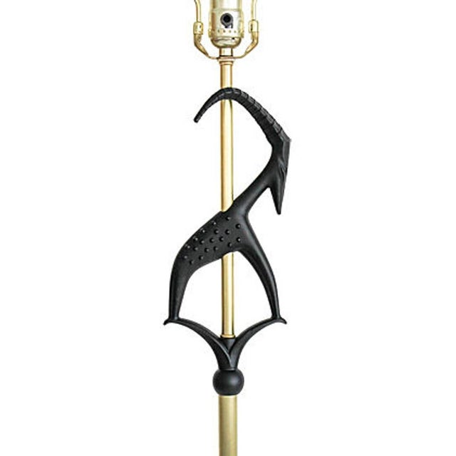 1950s gazelle floor lamp by Rembrandt. A black cast aluminum gazelle is mounted on a solid brass pole and disc base. It...