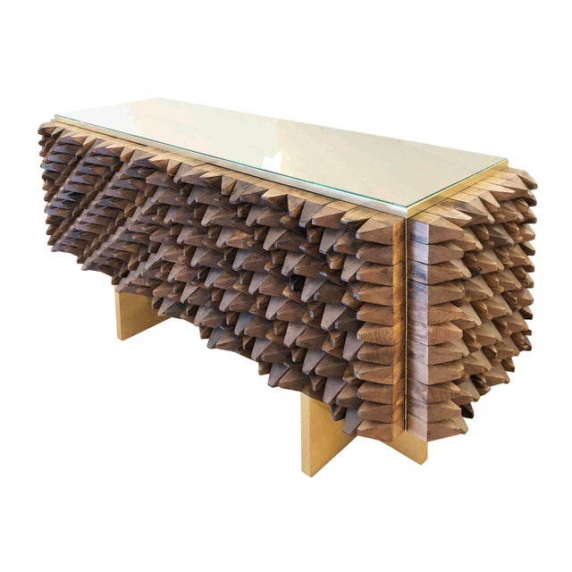 Handmade credenza by Interno 43 for Gaspare Asaro composed of dozens of carved wooden blocks pointing in different...