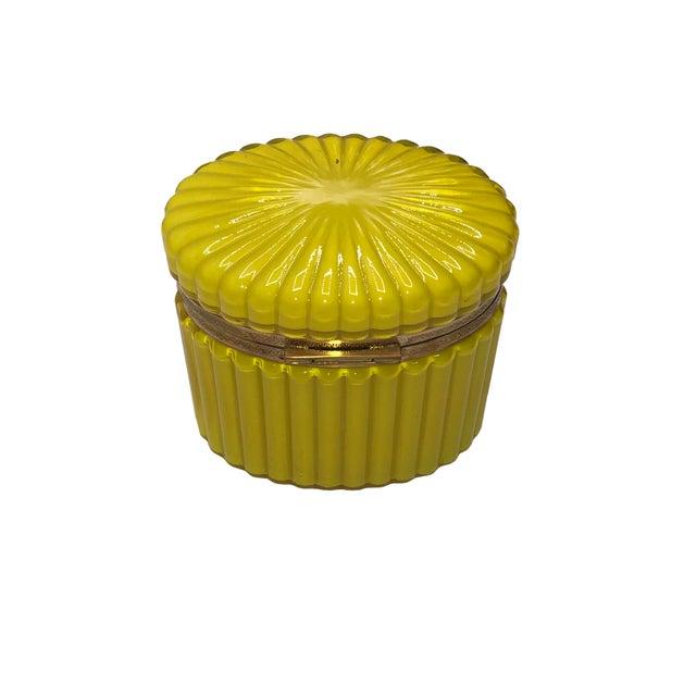 A bright Lemmon yellow Murano opaline oval box. Italy circa 1950.