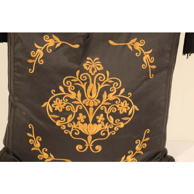 Black silk decorative accent pillow with tassels. Gold embroidered silk with four large tassels. Baroque gold floral decor...