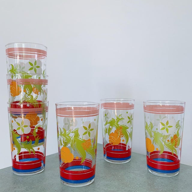 Absolutely fabulous vintage juice glasses with colorful floral detailing.