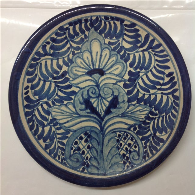 Mid-century Puebla Amora Talavera wall hanging featuring a classic blue slip tin glaze. A terrific, colorful accent to any...