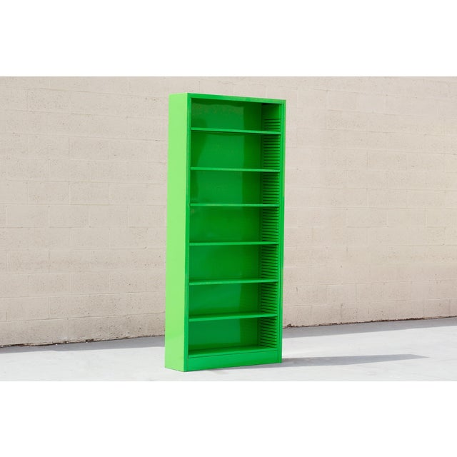 It's the 1970s tall tanker bookcase refinished in high gloss Lime Green. This minimal unit with 6 adjustable shelves is...