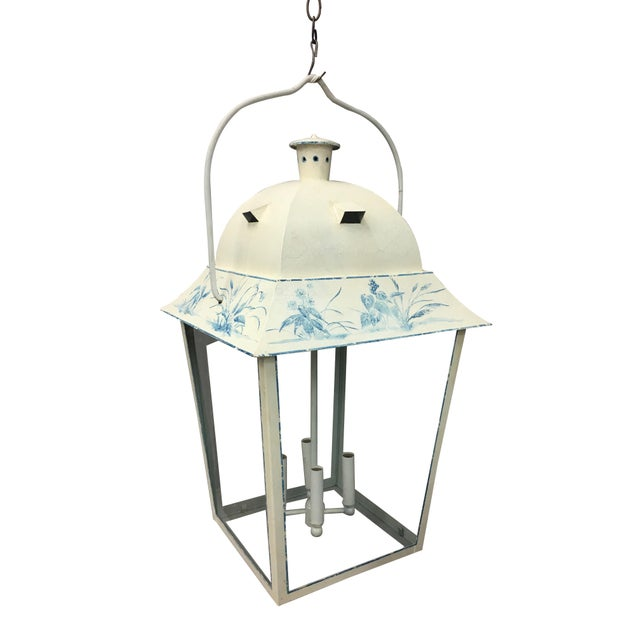 This delicately painted lamp modeled after the french country style makes an elegant addition to any home. With four...