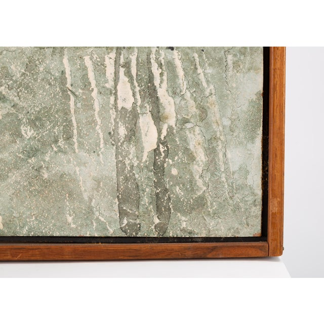 An unsigned relief painting with a natural wood frame. The painting wich is abstract in style, borrowing elements from...
