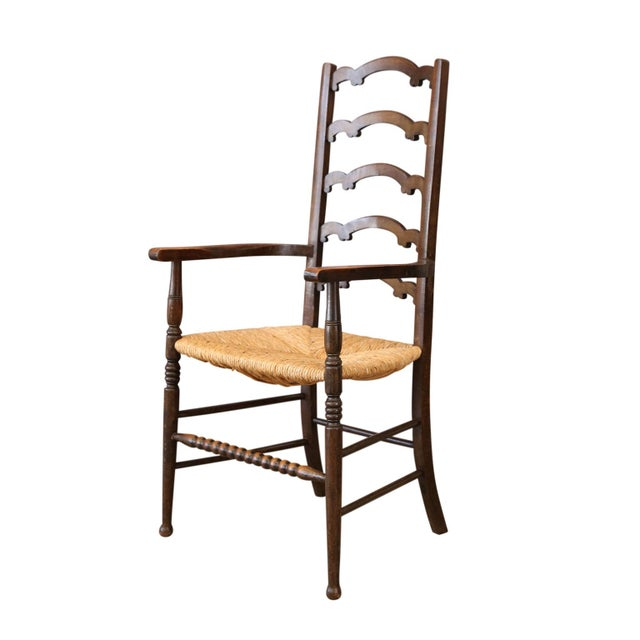 Unique ladder-back chairs carved with unusual, almost whimsical, scallop-shaped back splats, nice curved arms and a front...