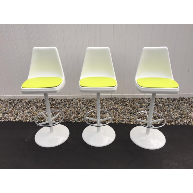 Perfect for your man cave, kitchen island, or retro bar are these three tulip base swivel bar stools. Bar stools are...