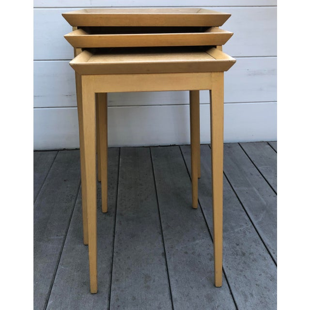 Three-piece nesting stacking table set by British-born architect and furniture designer T.H. Robsjohn-Gibbings for...