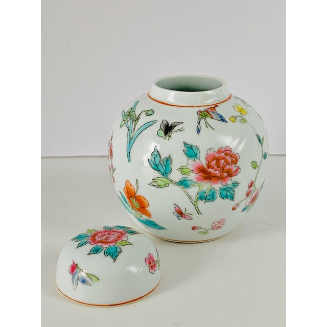 Vintage Chinese white porcelain Ginger jar with lid. Hand painted traditional asian floral sherry blossoms, butterflies...