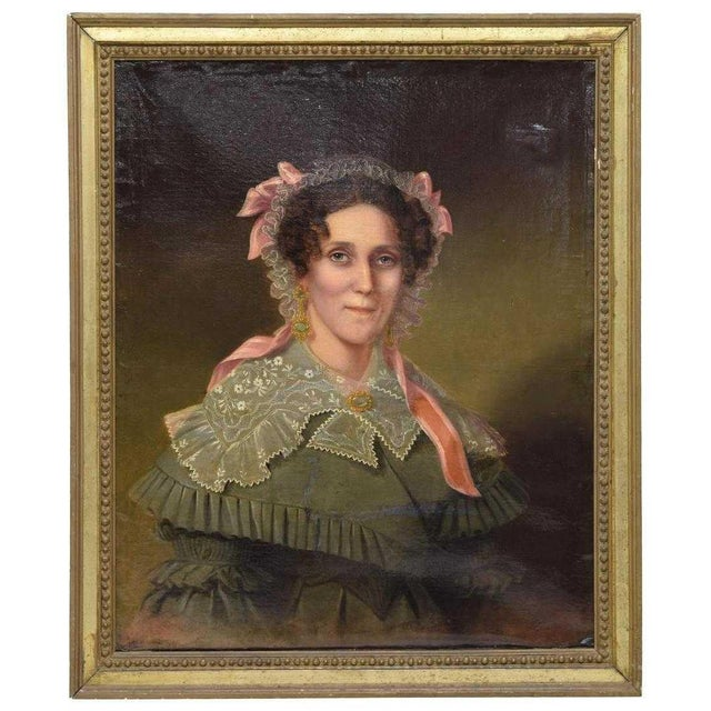 Framed oil on canvas, Portrait of an early American Woman in Lace Bonnet, 19th c. This lovely portrait of a 19th century...
