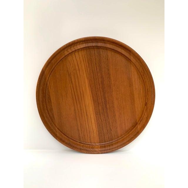 "Rare teak platter from renowned Georg Jensen designer, Henning Koppel ca. 1960s. The tray measures about 16.25"" diameter..."