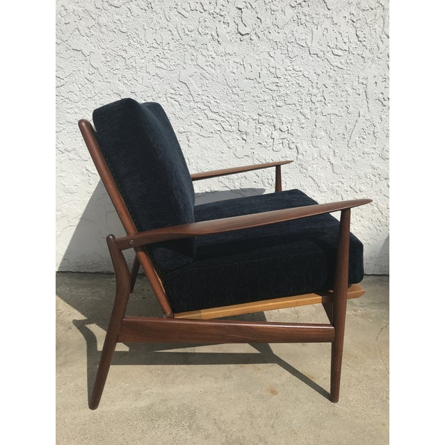 """Beautiful and much sought after """"Spear Chair"""" by Ib Kofod-Larsen. Refinished with new cushions in deep navy velvet tweed."""
