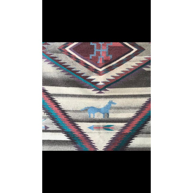 This is a super cute Navajo style rug. Handwoven, mirror image on back. Add some bohemian chic to your home! Perfect size...