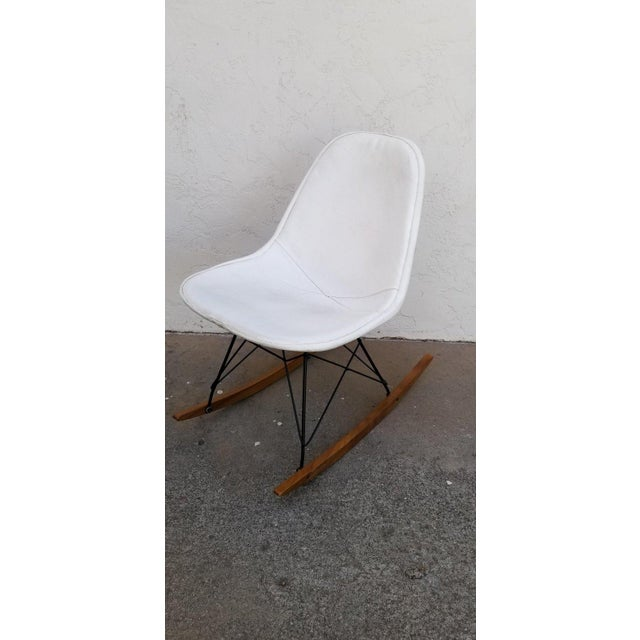 Vintage Herman Miller seat with original Naugahyde cover. Wire base is an aftermarket, replacement. Bold black and white...