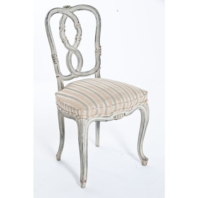 Carved and painted 'ribbon' back side chair. A lovely vintage piece with shabby chic flare.
