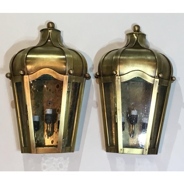 Pair of beautiful hand crafted wall mounted brass lantern and seeded glass ,artistically made . electrified with three...