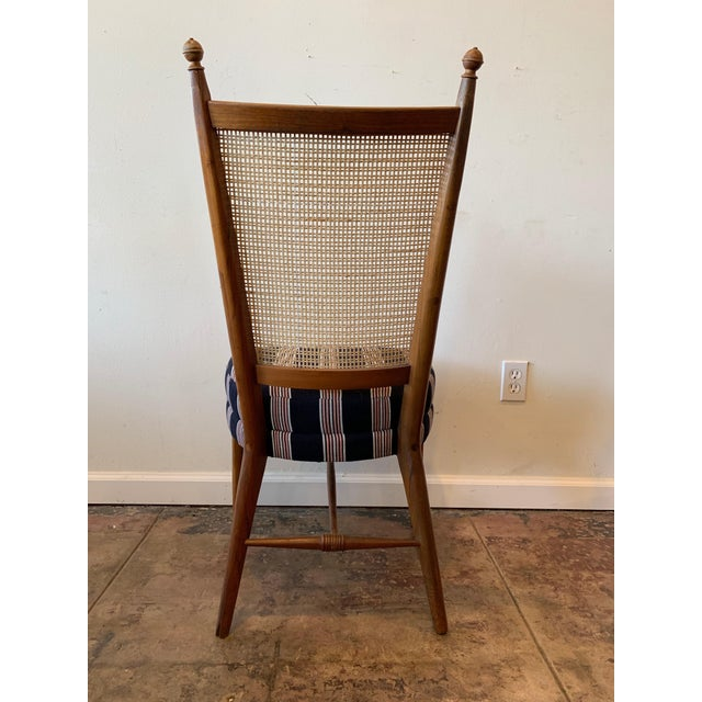 Gorgeous stylized vintage caned backed dining chair with generous upholstered seat - fabric is a reproduction of a french...
