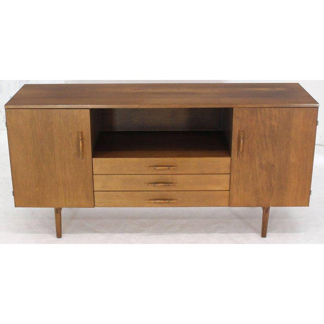 Nice wooden handles three compartments three drawers Paul McCobb credenza. Nice TV base cabinet. Excellent original...