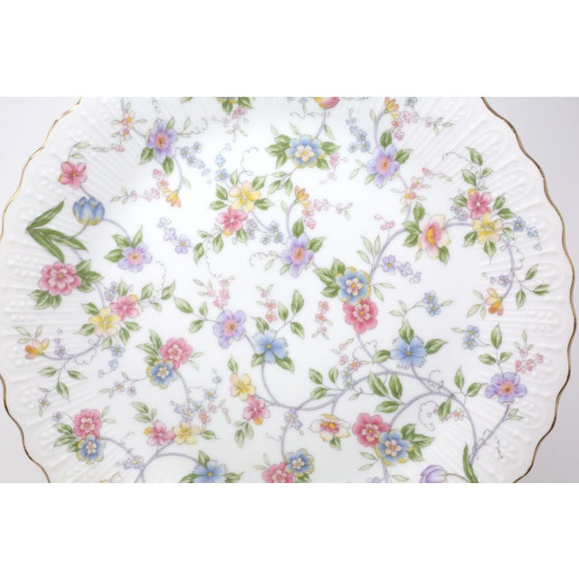"""A set of three pieces of """"Corona"""" pastel floral chintz dinnerware - a pedestal cake plate, dinner plate, and plate for..."""