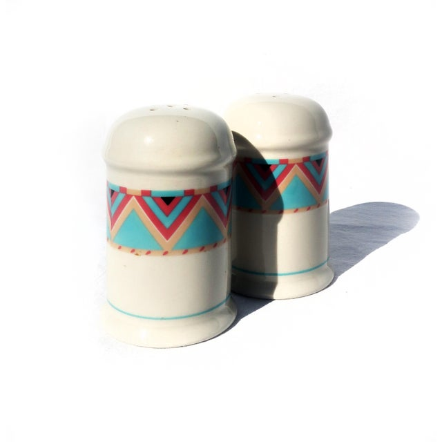 An amazing set of vintage Southwestern print salt & pepper shakers in excellent condition. Off-white base glaze with...