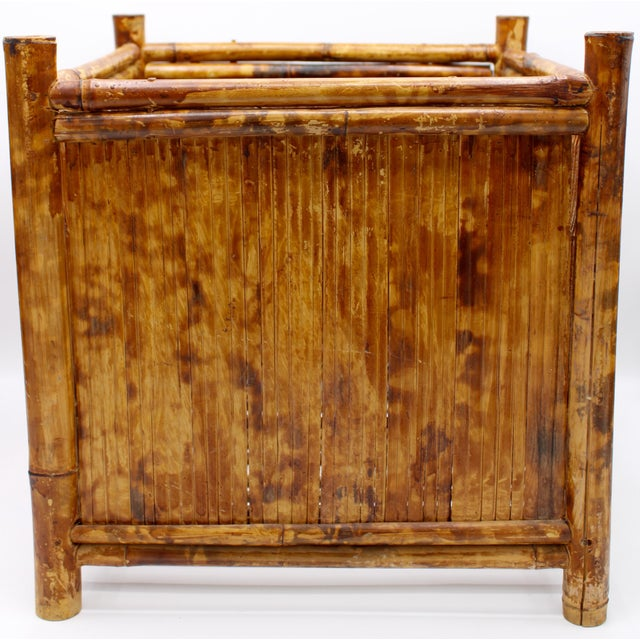 This is a vintage burnt bamboo square basket that has great coloration, circa 1960s. It is an eye catching, in vogue piece...